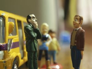 Two figurines talking and listening